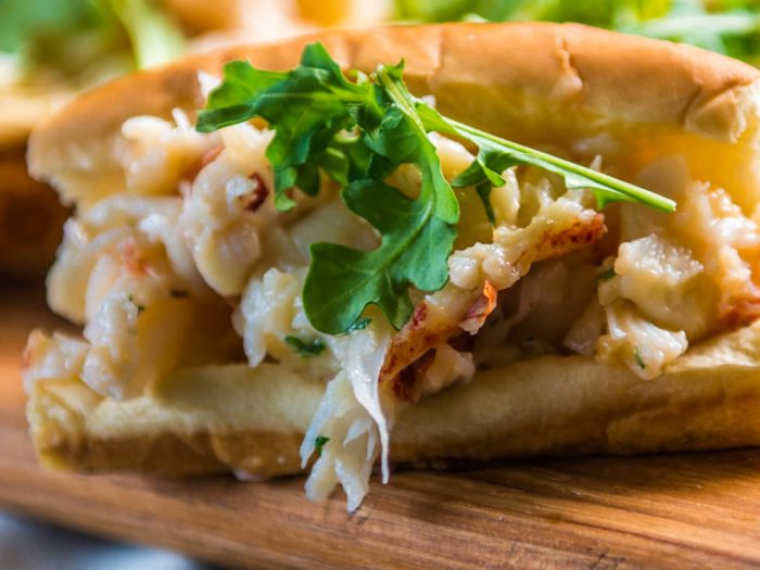 Let the good smoke roll out of the Traeger, these smoke infused grilled lobster rolls are a great way to kick-up the flavor on an East Coast favourite.